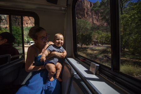 A woman with her baby boy are trekking in Zion national park, Utah, USA