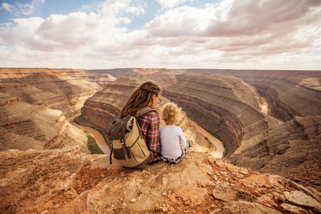 Mother with son relax in Goosenecks state Park,  USA Stock Photo