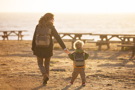 Happy family have a fun in pasific ocean
