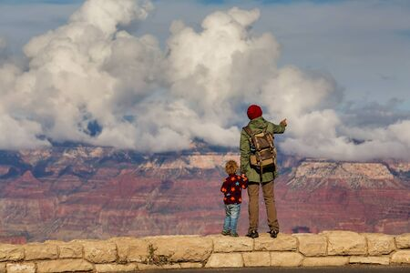A man with his son are hiking in Grand canyon National Park Reklamní fotografie