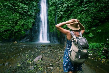 Woman near Munduk waterfal on Bali, Indonesia