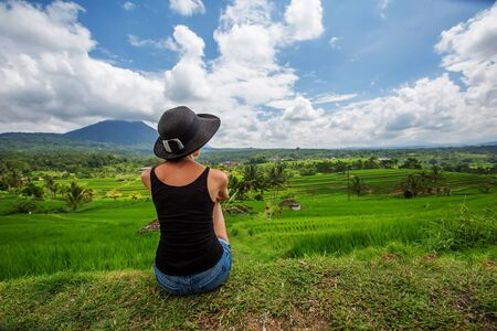woman looking at rice terrace in Bali, Indonesia