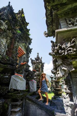 Woman tourist in a temple on the island of Bali