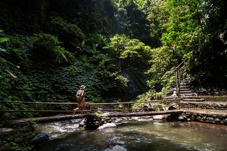 Woman near Nung Nung waterfal on Bali, Indonesia Stok Fotoğraf