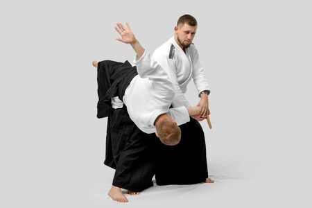 Two caucasian men are practicing aikido with waakizashi (isolation path included)