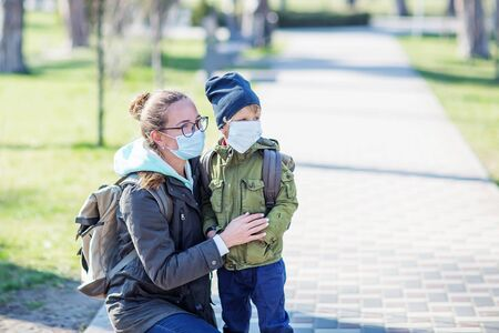 Mother and her son outdoor wearing masks Foto de archivo