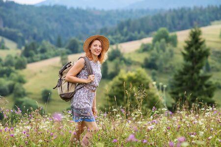 woman hiker enjoy the view at mountain Фото со стока