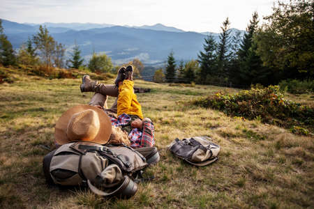Happy family resting in the mountains in autumn 版權商用圖片