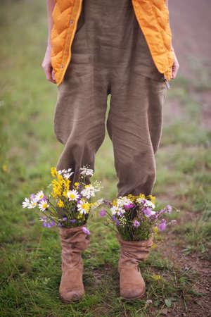 garden flowers in boots in autumn season