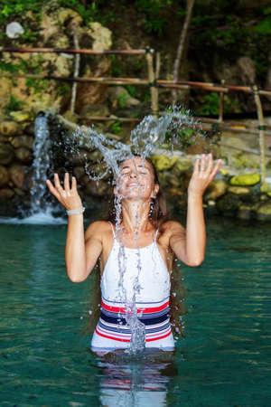 Beautiful woman in the nature pool 版權商用圖片