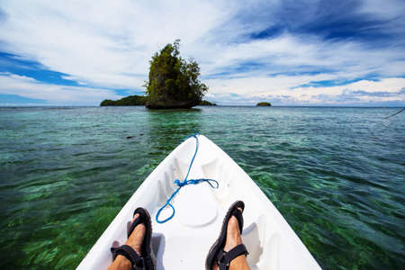 Man kayaking in the sea of Togean islands, Sulawesi, Indonesia