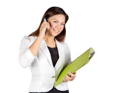 Office woman talking on mobile phone wity green file photo
