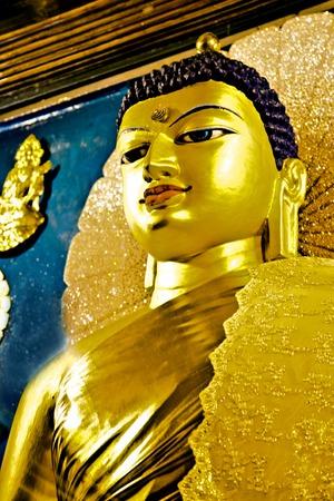 bihar: Golden Buddha in the Mahabodhi Temple, Bodhgaya, Bihar, India Stock Photo