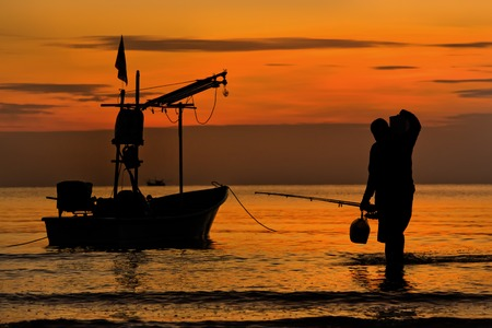huahin thailand fisherman back from fishing at sea photo
