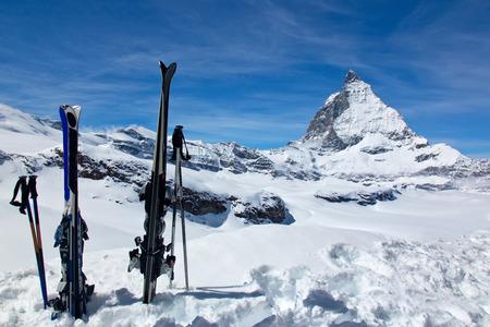A pair of skis against the Matterhorn, taken in the resort of Zermatt, Switzerland. photo