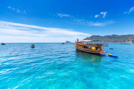 Thai boat in gulf of thailand sea near the tao island photo