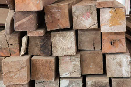 stack of lumber in timber logs storage for construction or industrial work , texture background photo