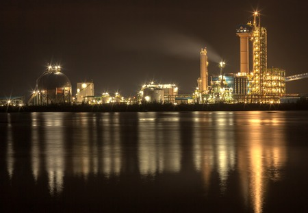 panorama of Oil refinery with reflection, petrochemical plant photo