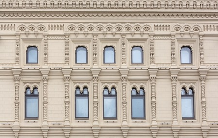 building front wall with repeting pattern of windows. moscow russia
