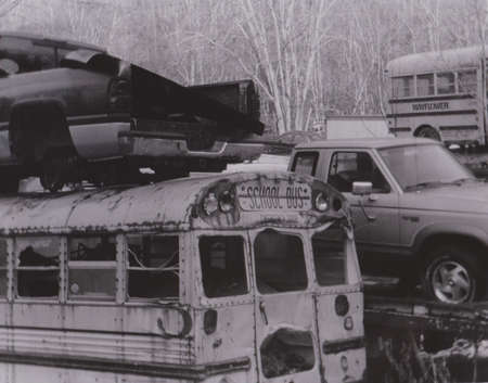 salvage yard: Vehicles stacked at Junk Yard, Black and White