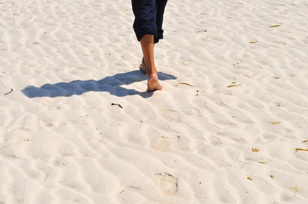 Walk on the beach leaving footprints on the road photo