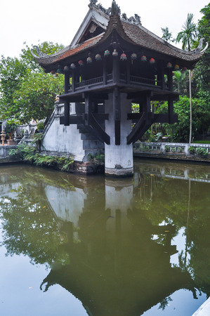 One Pillar Pagoda in Hanoi, Vietnam with its reflection in the lake