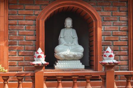 tran: figure of a buddha in Tran Quoc pagoda in Hanoi in Vietnam