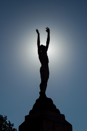 icarus: icarus statue backlit with arms outstretched