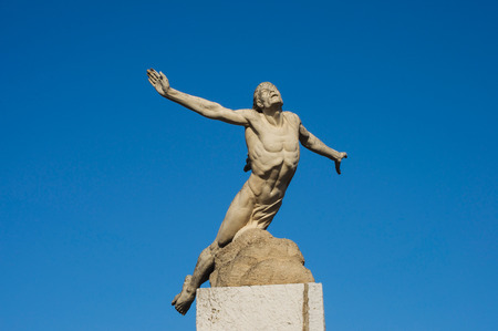 icarus: icarus statue trying to fly to the sun Stock Photo