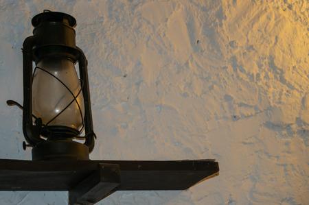 oil lamp: oil lamp on a shelf