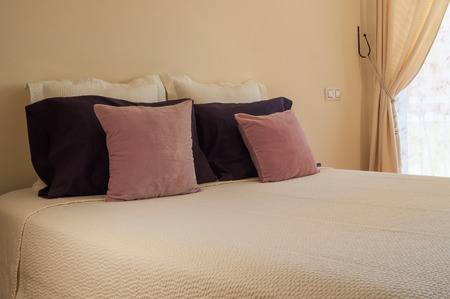 sleeping pad: double bed with purple cushions