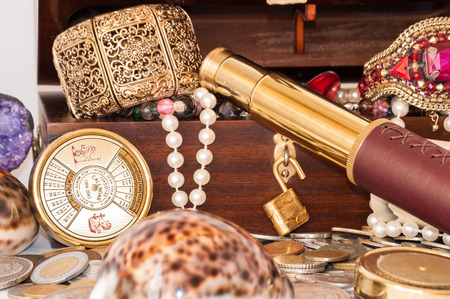 Pirate treasure chest with pearls, jewels, coins and glass photo