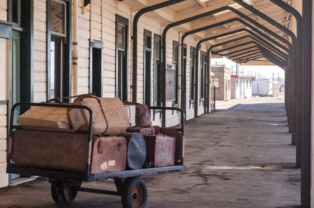 old suitcases on the platform of the station Oamaru in New Zealand photo