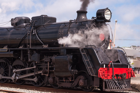Classic old steam train in the station photo