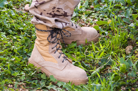 combat boots: military combat boots arid color and camouflage suit