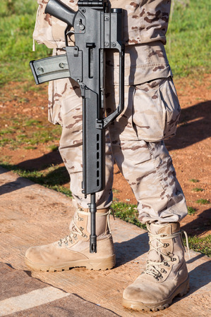 assault rifle: HK G36 assault rifle on shoulder of a soldier