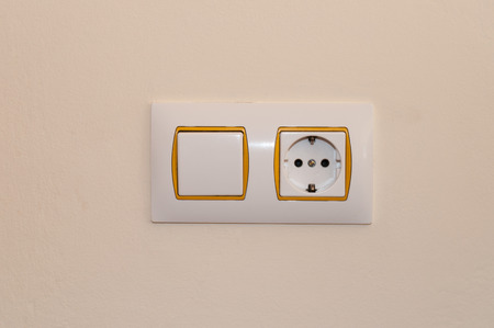 wall socket: switch and wall socket with orange border Stock Photo