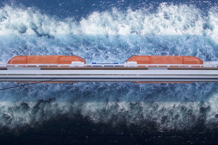 Mirror waves on boat. The rescue bot and sea foam reflect in a cruise liner windows.