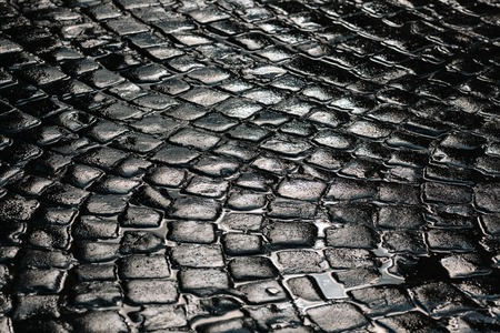 Stone pavement texture. Granite cobble stoned pavement background. Abstract background of old cobblestone pavement close-up