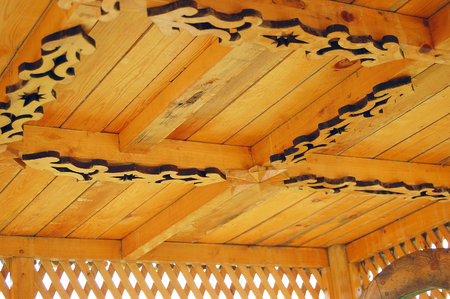 circumstance: Carved wooden tower over the well at lake Igjboolat Sverdlovsk region. detail, circumstance