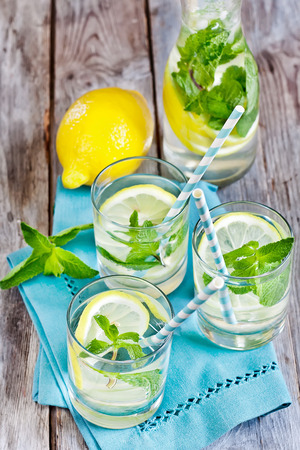 Mint lemonad in glasses and pitcher. Selective focus. photo