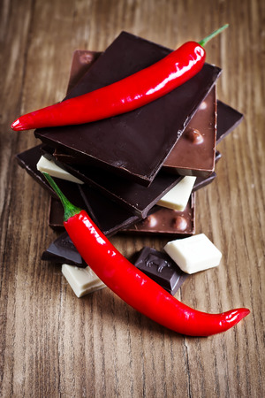 Mix chocolate tower with red hot chili pepper. photo