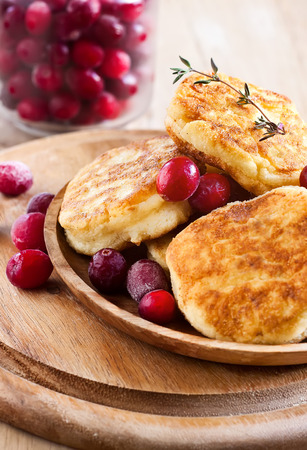 Russian quark pancakes with cranberry. Selective focus. photo