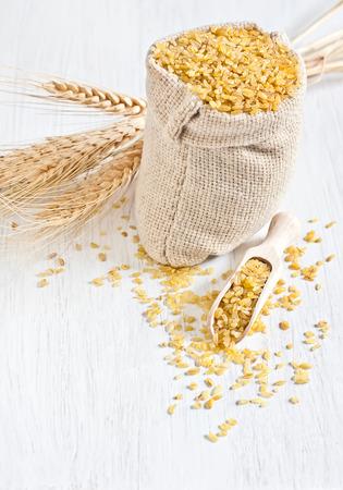 durum wheat semolina: Raw cracked durum wheat or bulgur in bag. Popular ingredient in Middle Eastern cuisine.