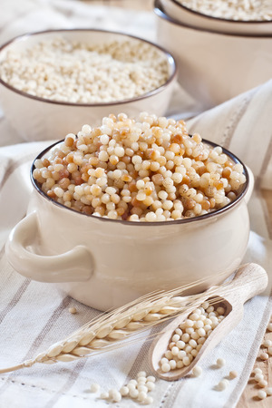 Ptititm or israel couscous - kind of small pasta, traditional for israel cuisine. photo