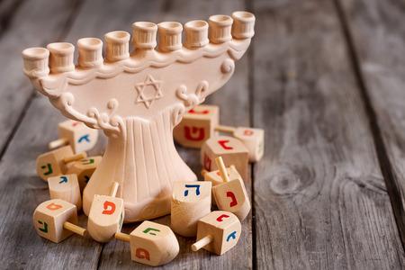 hannukah: Jewish holiday hannukah symbols - menorah and wooden dreidels. Copy space bacground.