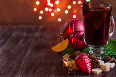 Christmas mulled wine with spices and orange. Selective focus. Copyspace background.