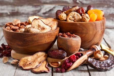 Mix of dried fruits and almonds - symbols of judaic holiday Tu Bishvat. Stock Photo