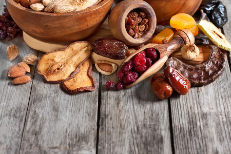 shvat: Mix of dried fruits and almonds - symbols of judaic holiday Tu Bishvat. Copyspace background. Stock Photo