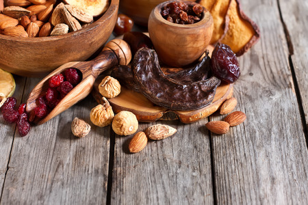 fig: Mix of dried fruits and almonds - symbols of judaic holiday Tu Bishvat. Copyspace background. Stock Photo